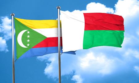 amity: Comoros flag with Madagascar flag, 3D rendering