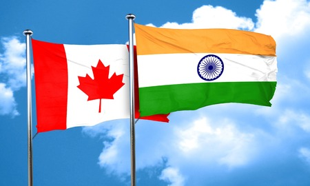 india culture: Canada flag with India flag, 3D rendering Stock Photo