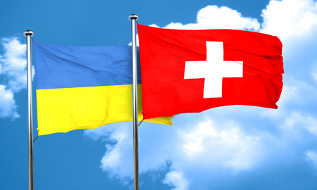 ukraine flag: Ukraine flag with Switzerland flag, 3D rendering Stock Photo