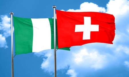 nigeria: Nigeria flag with Switzerland flag, 3D rendering Stock Photo
