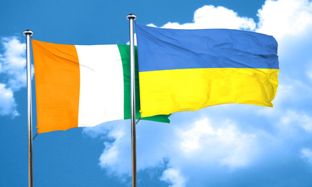 ivory: Ivory coast flag with Ukraine flag, 3D rendering
