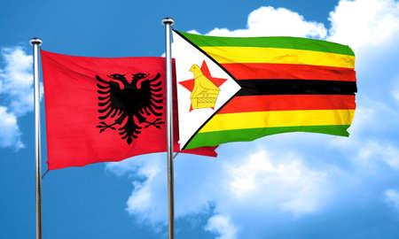 albania: Albania flag with Zimbabwe flag, 3D rendering Stock Photo