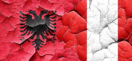 bandera peru: Albania flag with Peru flag on a grunge cracked wall