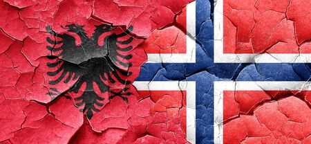 norway flag: Albania flag with Norway flag on a grunge cracked wall