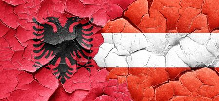 cracked wall: Albania flag with Austria flag on a grunge cracked wall