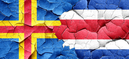 rican: aland islands with Costa Rica flag on a grunge cracked wall