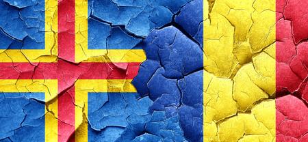 romania flag: aland islands with Romania flag on a grunge cracked wall