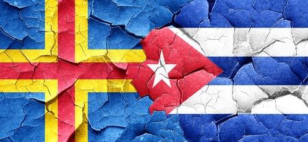cuba flag: aland islands with cuba flag on a grunge cracked wall Stock Photo
