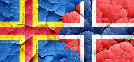 norway flag: aland islands with Norway flag on a grunge cracked wall