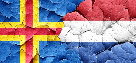 cracked wall: aland islands with Netherlands flag on a grunge cracked wall Stock Photo