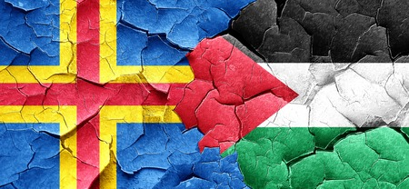 palestine: aland islands with Palestine flag on a grunge cracked wall Stock Photo