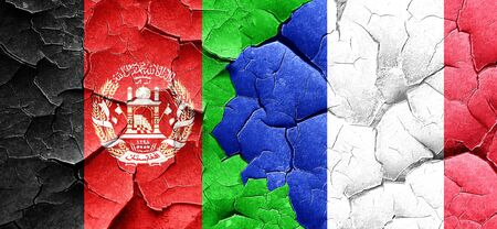afghan: Afghanistan flag with France flag on a grunge cracked wall Stock Photo