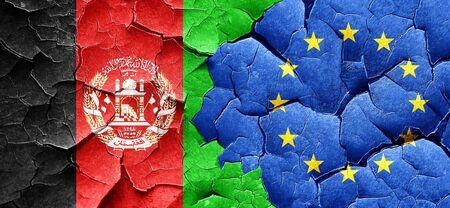 afghan: Afghanistan flag with european union flag on a grunge cracked wall
