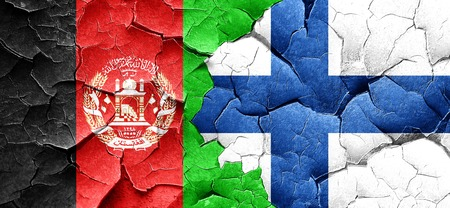 Afghanistan flag with Finland flag on a grunge cracked wall Stock Photo