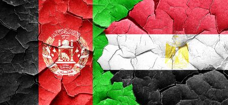 afghan: Afghanistan flag with egypt flag on a grunge cracked wall Stock Photo