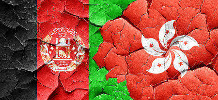 afghan: Afghanistan flag with Hong Kong flag on a grunge cracked wall