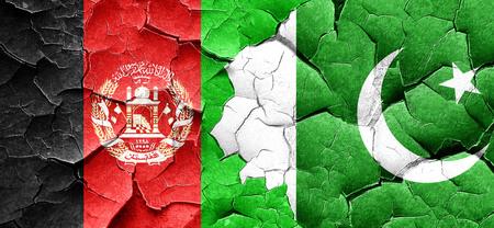 afghanistan flag: Afghanistan flag with Pakistan flag on a grunge cracked wall
