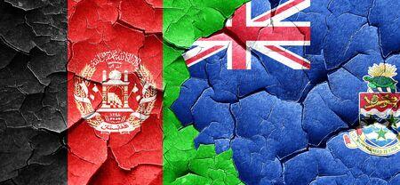 afghanistan flag: Afghanistan flag with Cayman islands flag on a grunge cracked wall Stock Photo