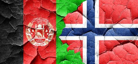 Afghanistan flag with Norway flag on a grunge cracked wall