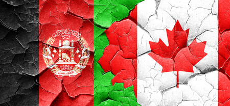 Afghanistan flag with Canada flag on a grunge cracked wall Stock Photo