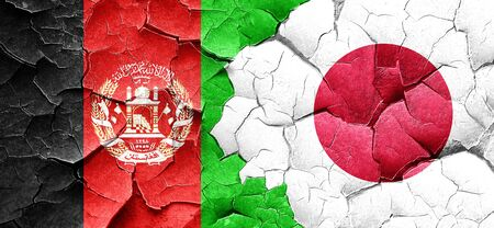 cracked wall: Afghanistan flag with Japan flag on a grunge cracked wall