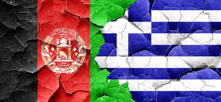 Afghanistan flag with Greece flag on a grunge cracked wall