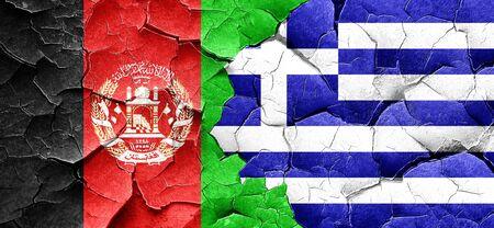 afghanistan flag: Afghanistan flag with Greece flag on a grunge cracked wall