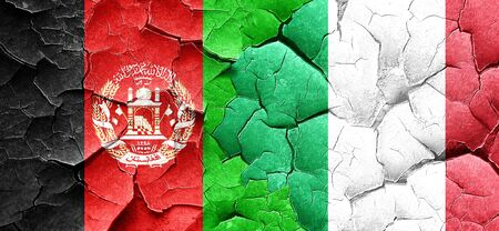 afghan flag: Afghanistan flag with Italy flag on a grunge cracked wall