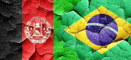 Afghanistan flag with Brazil flag on a grunge cracked wall Stock Photo