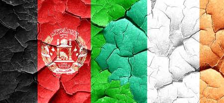 ireland flag: Afghanistan flag with Ireland flag on a grunge cracked wall