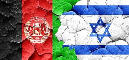 Afghanistan flag with Israel flag on a grunge cracked wall Stock Photo