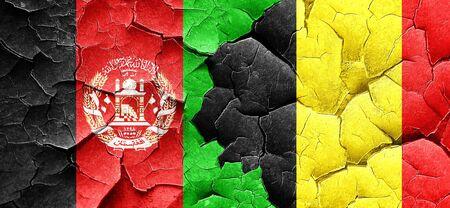 afghanistan flag: Afghanistan flag with Belgium flag on a grunge cracked wall