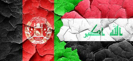 Afghanistan flag with Iraq flag on a grunge cracked wall