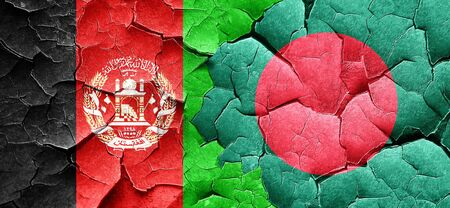 afghanistan flag: Afghanistan flag with Bangladesh flag on a grunge cracked wall