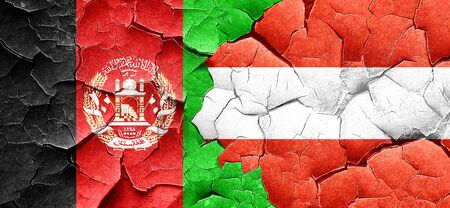 Afghanistan flag with Austria flag on a grunge cracked wall Stock Photo