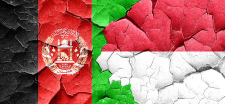 Afghanistan flag with Indonesia flag on a grunge cracked wall Stock Photo