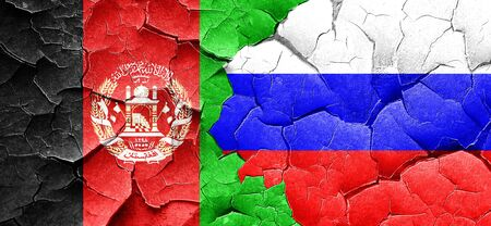 Afghanistan flag with Russia flag on a grunge cracked wall Stock Photo