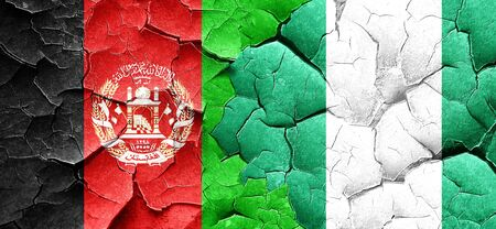 Afghanistan flag with Nigeria flag on a grunge cracked wall