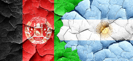 argentine: Afghanistan flag with Argentine flag on a grunge cracked wall