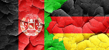 afghanistan: Afghanistan flag with Germany flag on a grunge cracked wall Stock Photo