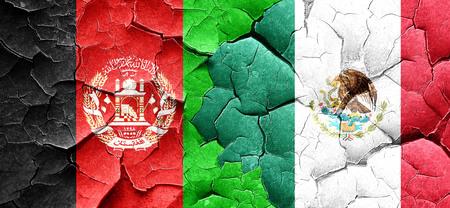 afghanistan flag: Afghanistan flag with Mexico flag on a grunge cracked wall