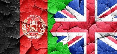 britain flag: Afghanistan flag with Great Britain flag on a grunge cracked wall