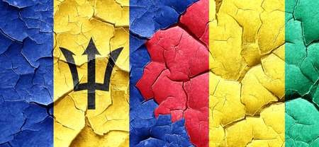 cracked wall: Barbados flag with Guinea flag on a grunge cracked wall