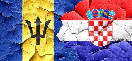 croatia flag: Barbados flag with Croatia flag on a grunge cracked wall