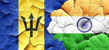 cracked wall: Barbados flag with India flag on a grunge cracked wall Stock Photo