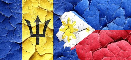 philippino: Barbados flag with Philippines flag on a grunge cracked wall