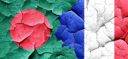 bangladesh: Bangladesh flag with France flag on a grunge cracked wall