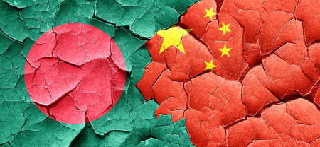 cracked wall: Bangladesh flag with China flag on a grunge cracked wall