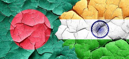 bangladesh: Bangladesh flag with India flag on a grunge cracked wall