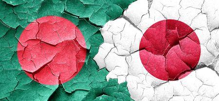 bangladesh: Bangladesh flag with Japan flag on a grunge cracked wall